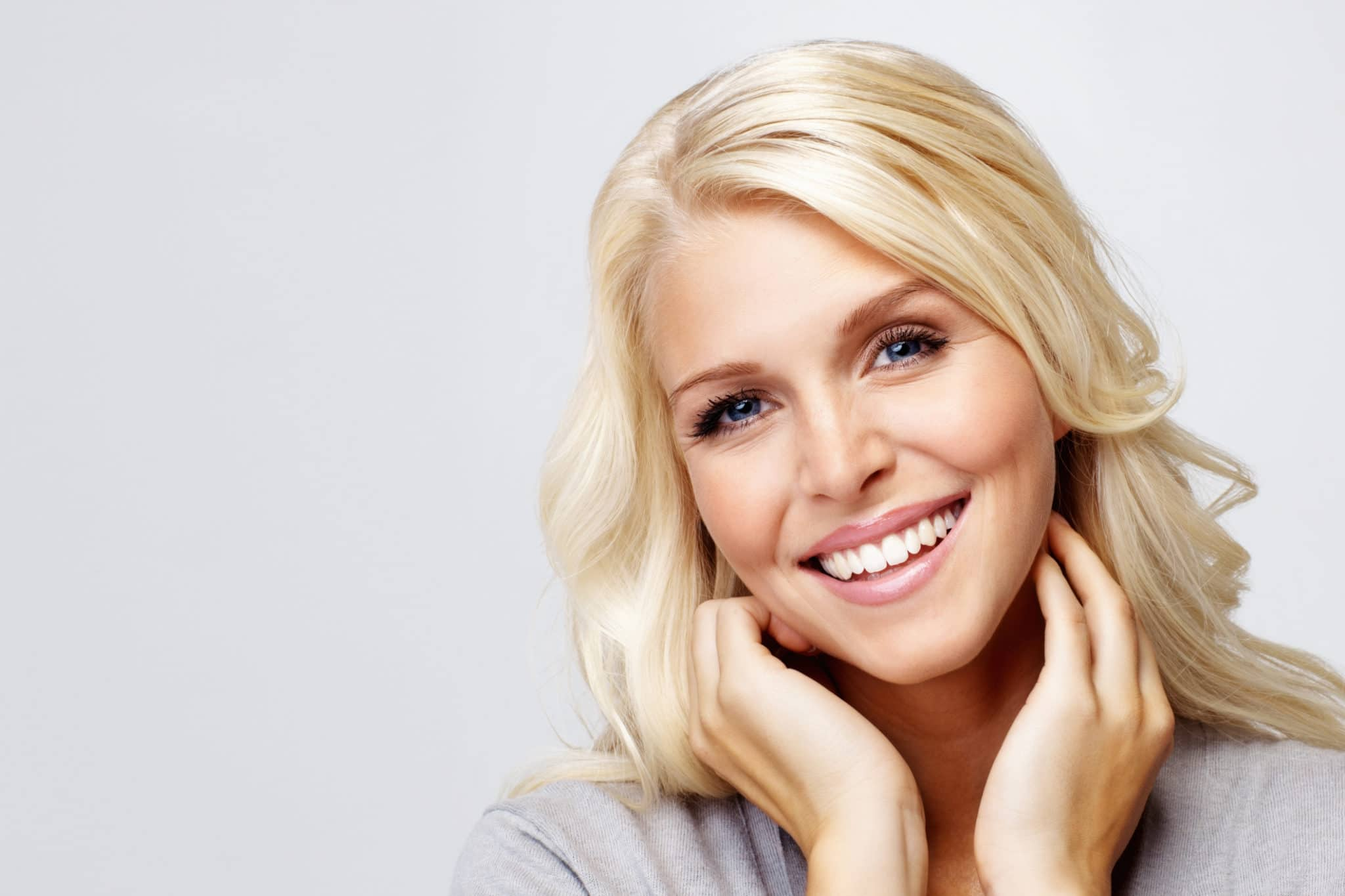 Close-up of a young, smiling blond woman stock photo
